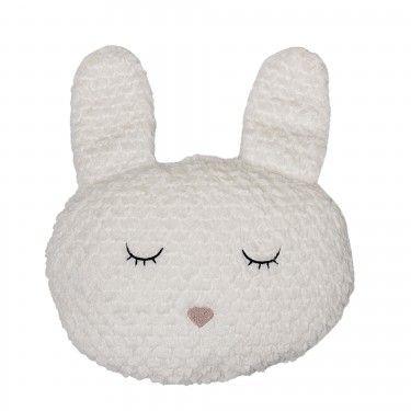 Cojín con forma de conejo.
