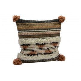 Cojín azteca en tonos terracota.
