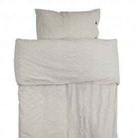 Funda de edredón y almohada blanco roto.