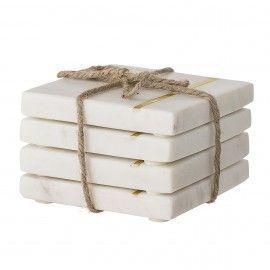Set posavasos de mármol blanco.