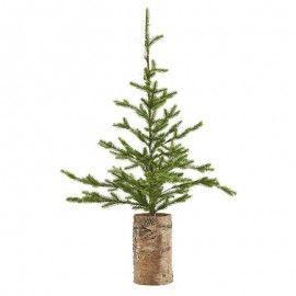 Árbol de Navidad con luces y base de madera.