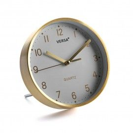 Reloj de mesa dorado.