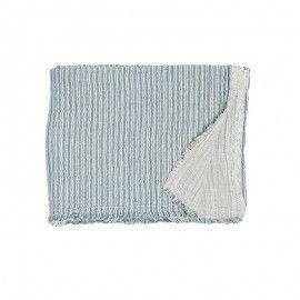 Plaid de lino a rayas azul.