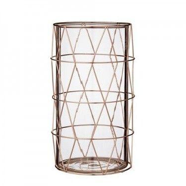 Portavelas de cristal cilíndrico con metal.