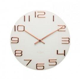 Reloj de cristal y cobre.