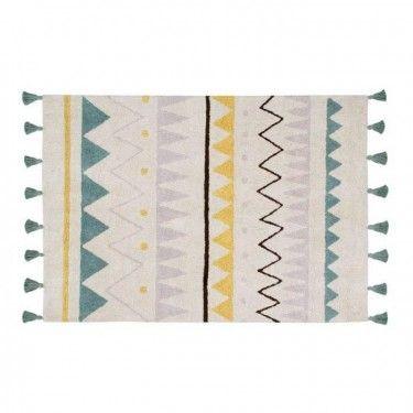 Alfombra con motivos aztecas de colores y borlas.