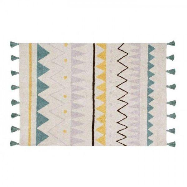 alfombra con motivos aztecas de colores y borlas