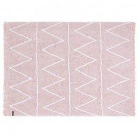Alfombra rosa con zigzag blanco y flecos. 120 x 160 cm.