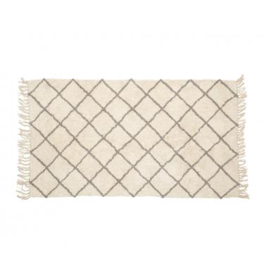 alfombra de algodón blanca y negra con flecos laterales