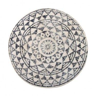 Alfombra redonda con estampado blanco y negro.80 cm.
