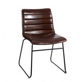 Silla de estilo vintage con asiento de ecopiel marrón oscuro.
